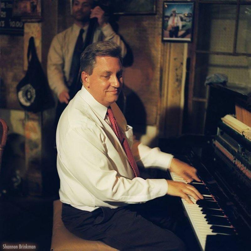 John at the piano